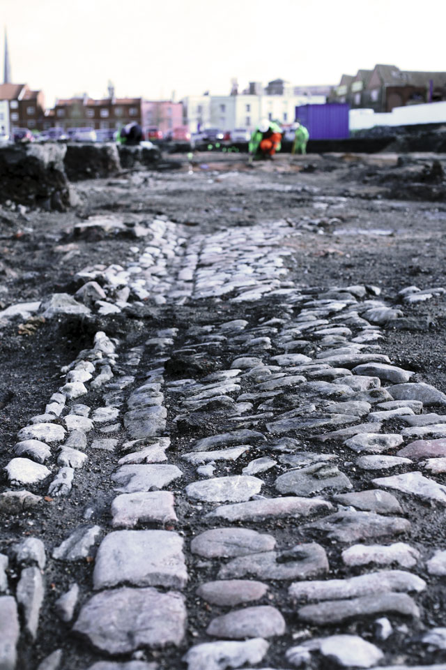 19th-century cobbled pavement at wapping wharf site in bristol