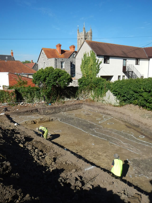archaeologists uncovering evidence of medieval occupation on a site in glastonbury