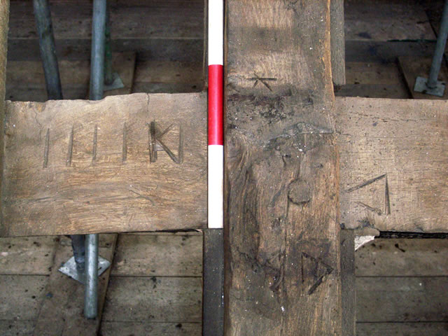 carpenters marks on a purloin and truss in the 17th century roof of hanham hall