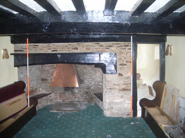 fireplace and stairwell in the live and let live public house at blagdon