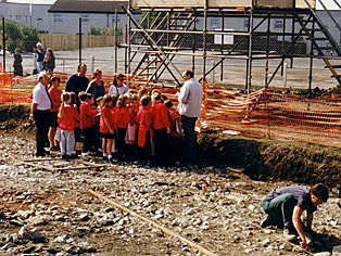a party of school children visiting an archaeological site